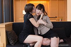 Girls Embracing On Sofa