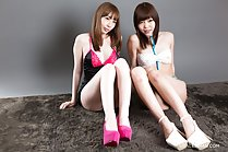 Girls seated in lingerie knees drawn up wearing high heels